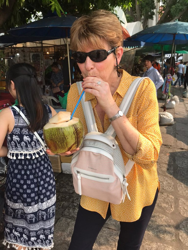 Enjoying my first fresh coconut | Photo taken by Deborah B