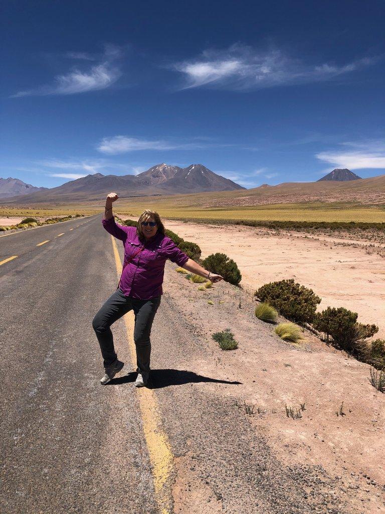 Melody on the highway heading to San Pedro de Atacama | Photo taken by Melody B