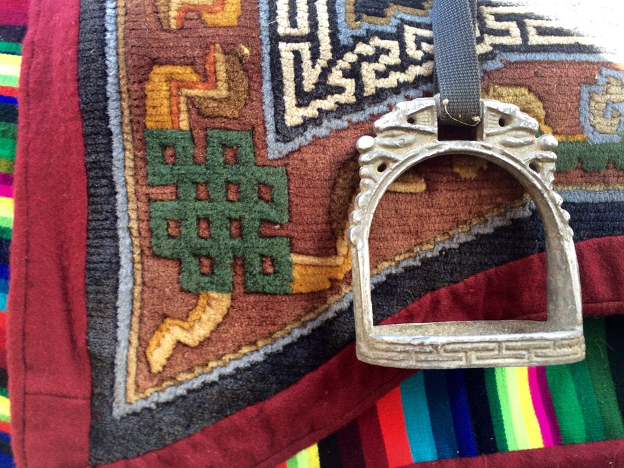 Saddle blanket and stirrup | Photo taken by Scott B