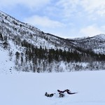 making a snow angel while ice fishing | Photo taken by Cyndi P
