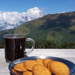 Morning coffee break in front of Dhaulagiri, the world's 7th highest peak. | Photo taken by William N