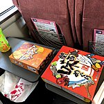 Bento boxes in the train | Photo taken by Joost S