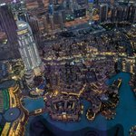 It was fascinating to watch the lights come on in the nearby buildings as dusk began.   - Burj Khalifa, Dubai, United Arab Emirates | Photo taken by Rich W