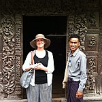 Jane and Nay in front of a teak carved door. | Photo taken by Rodney S