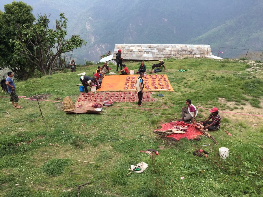Local men processing and distributing yak meat near Ghandruk | Photo taken by Andrew B
