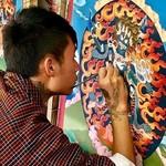 Student artist working on a mandala  | Photo taken by Lynne N