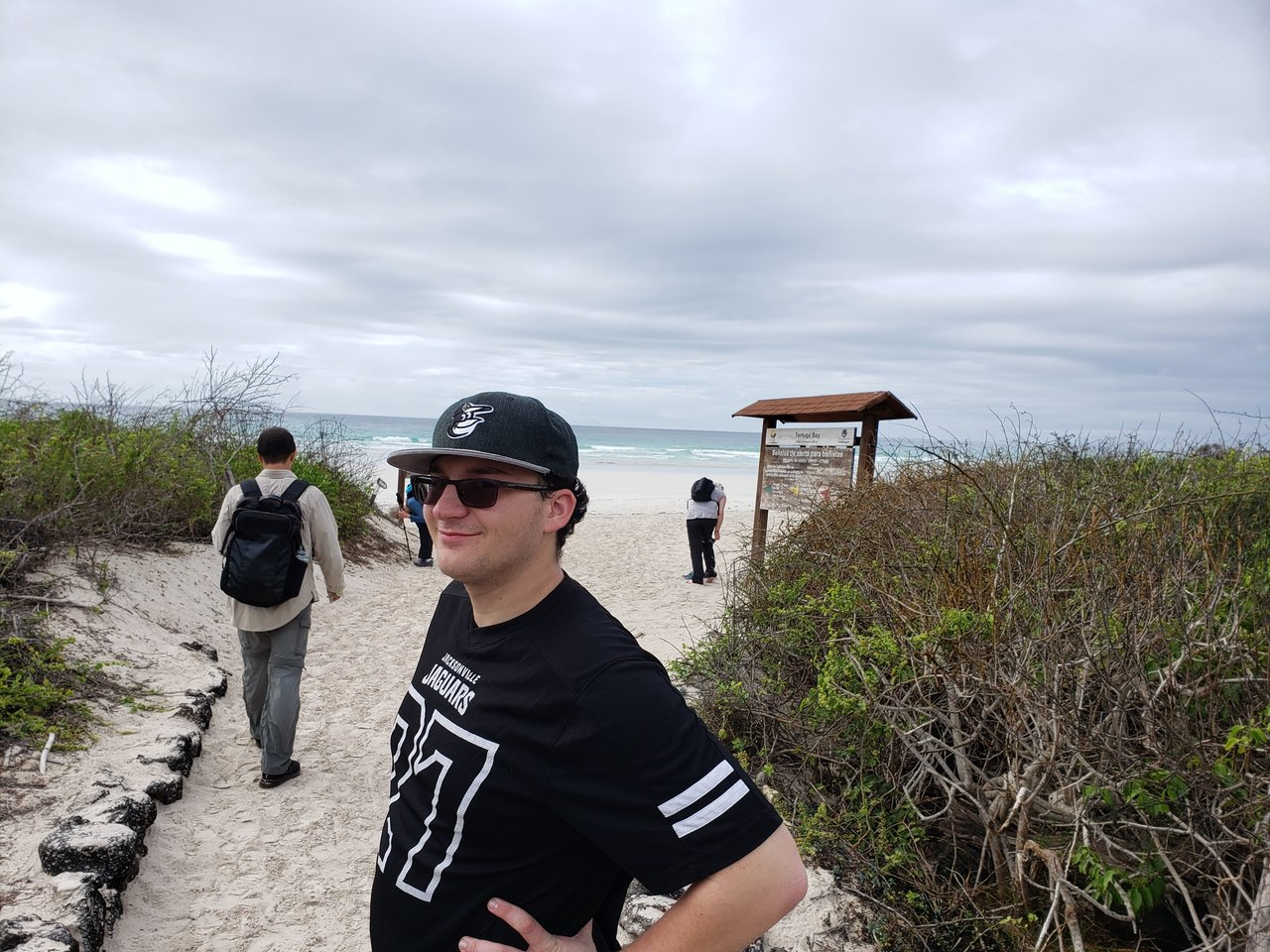 Arriving at Tortuga Bay after the a wild walk | Photo taken by Peter S