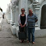 Buddhist temple hidden behind two tourists. | Photo taken by Rodney S