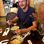 Feasting on noodles | Photo taken by Joost S