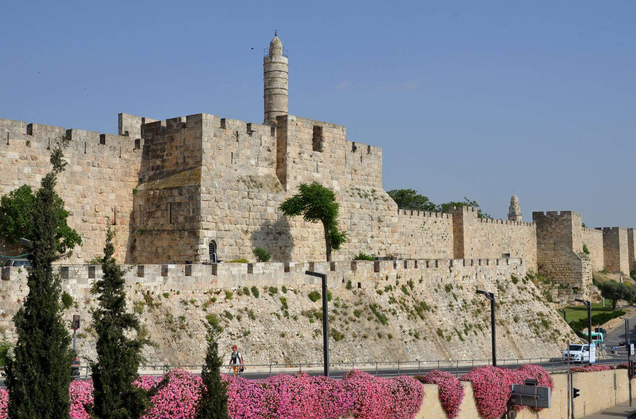 It was time to leave the Old City of Jerusalem. We had to take our bags to the bottom of this hill because our Palestinian Christian driver's permit only allowed him to drive in the new part of Jerusalem.  - Wall of Old City of Jerusalem, Israel | Photo taken by Rich W