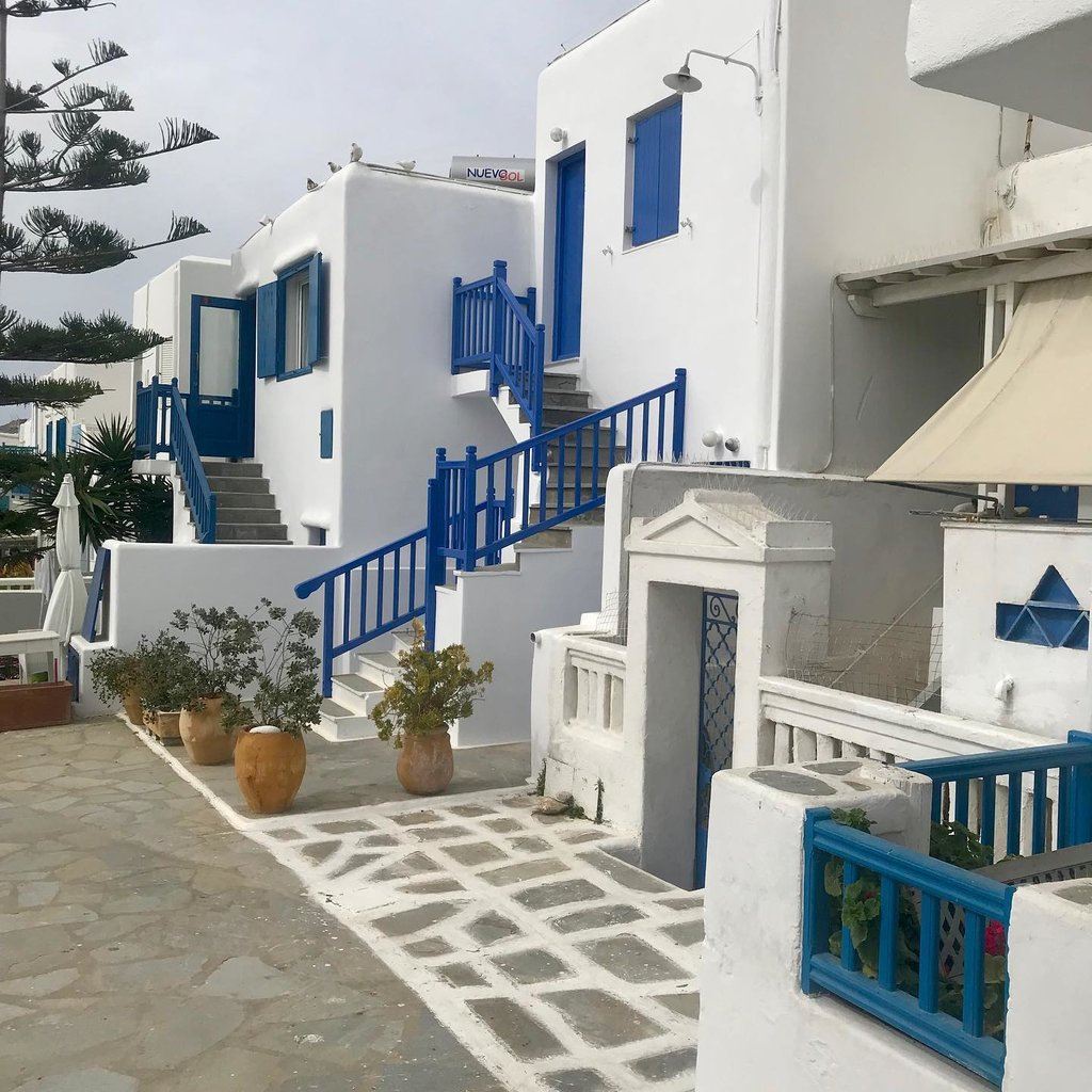 blue and white buildings downtown Mykonos | Photo taken by Sue S