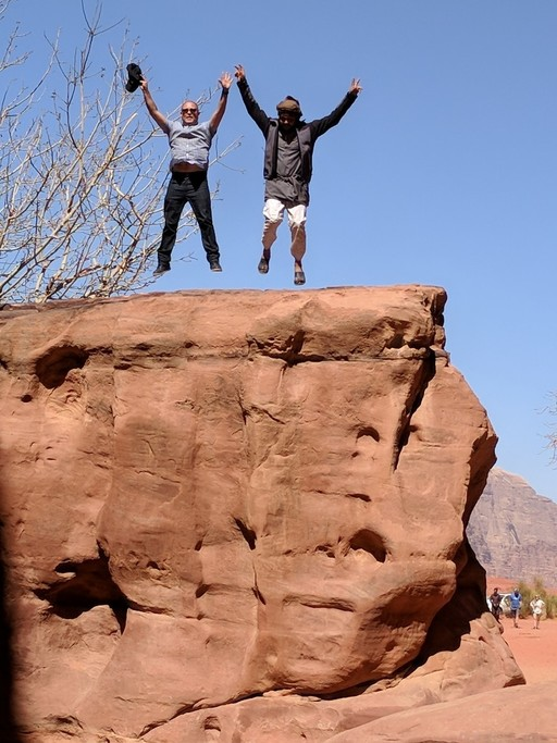 With the Bedouin guide at Wadi Rum | Photo taken by Vinita N