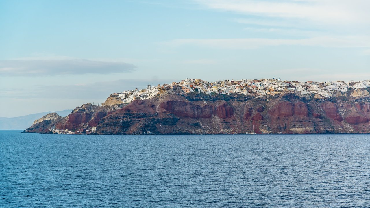 Iron rich sedimentary rocks in cliff face of Oia | Photo taken by David B