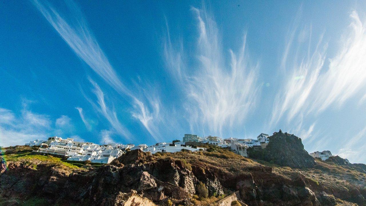 Feathered clouds framing Imerovigli | Photo taken by David B