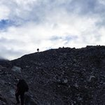 Trekking across one of the glaciers on the way to the Cho La Mountain Pass. Nothing but down on the other side of those rocks. | Photo taken by Anita P