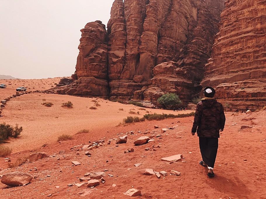 My guide Hussain leading me to Khazali Canyon in Wadi Rum | Photo taken by Jennifer K