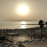 Many people gather at watch the sunset at the beaches in Tel Aviv. There are loads of restaurants and bars, as well as vendors who rent chairs, lounges, and umbrellas at the beach. | Photo taken by Rich W