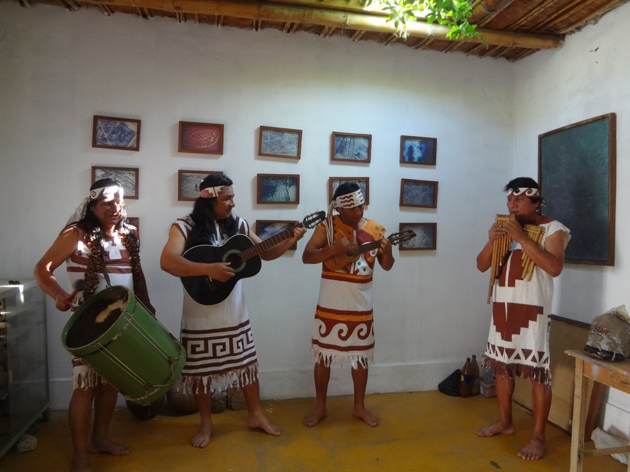 Los Caimanes playing traditional music using Mochica instruments | Photo taken by Bev D