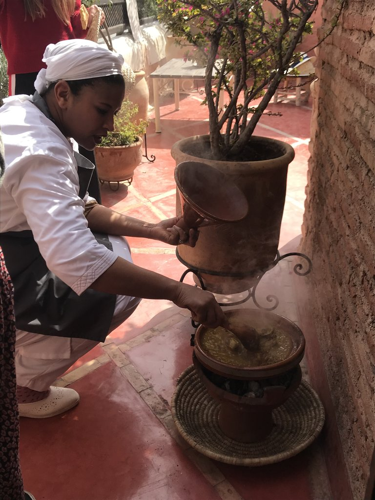 Checking the Tagine | Photo taken by Chris M