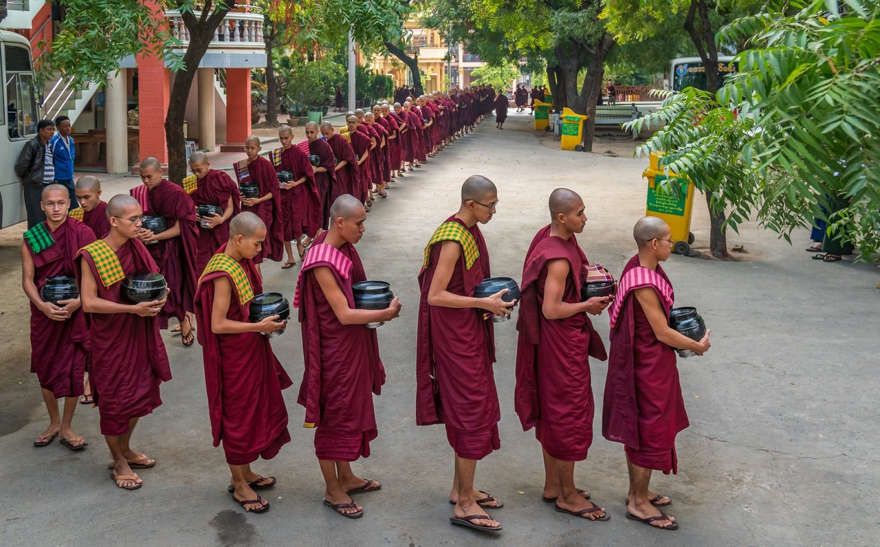 Buddhist monks lining up to receive their last meal of the day | Photo taken by Tack S