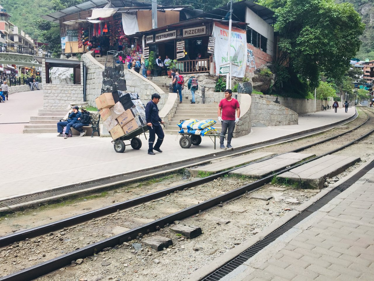 No cars, so when the train arrives to restock the restaurants, these guys don't waste any time | Photo taken by Matthew M
