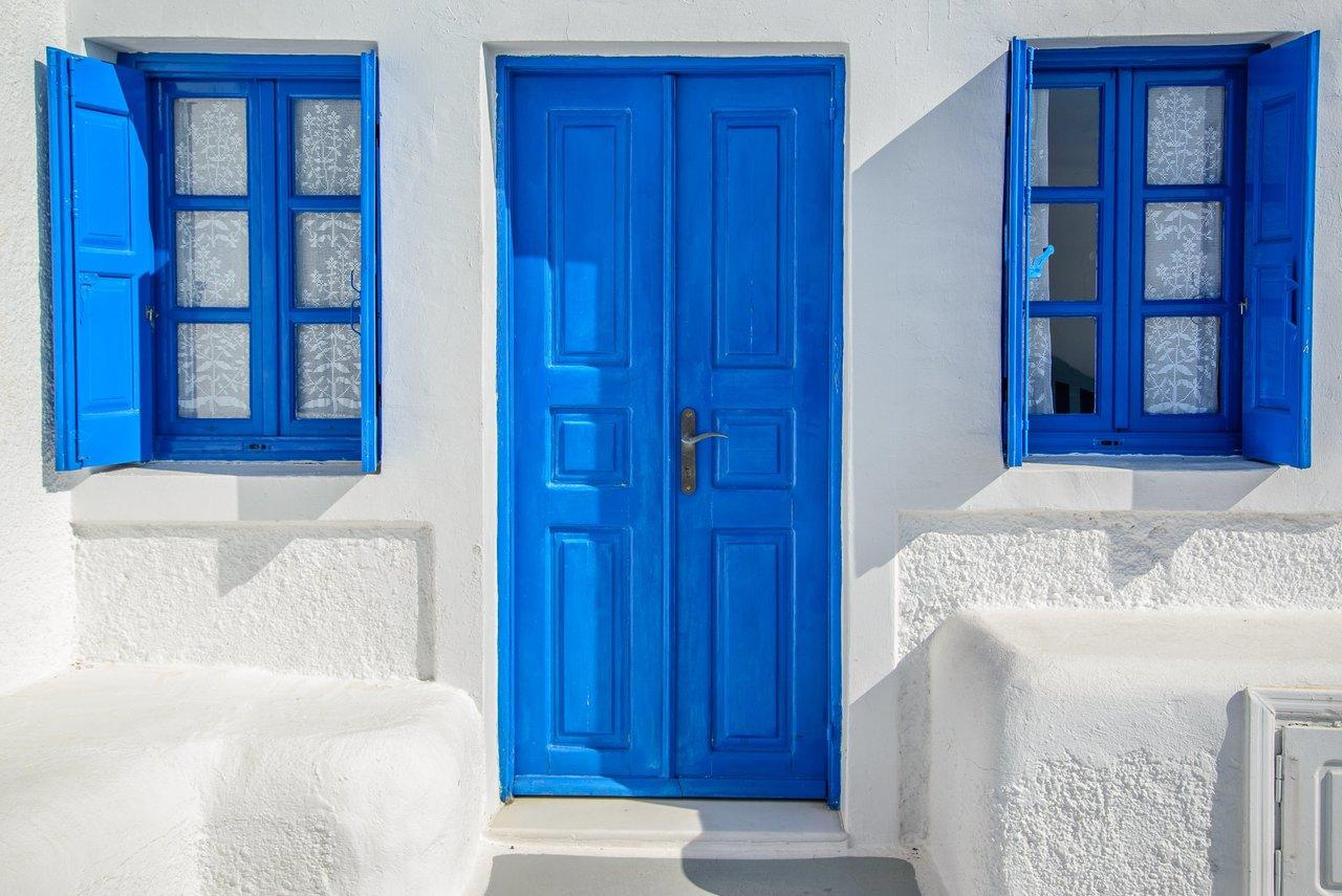 Blue door and windows of Santorini | Photo taken by David B
