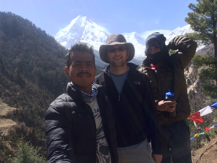 Louis, prakash, and krishna (guide and porter) in front of manaslu from the village of loh | Photo taken by Louis f