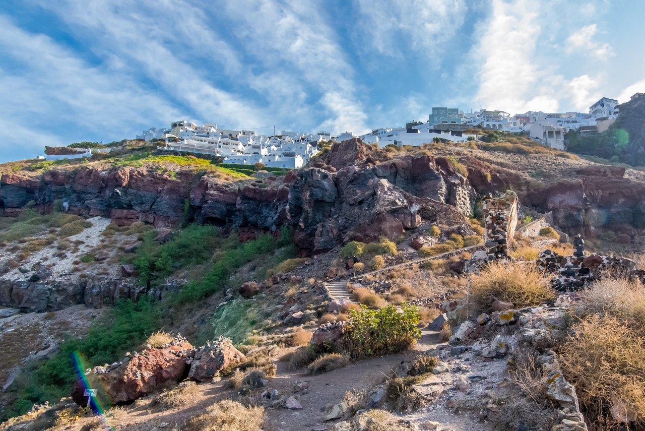 Imerovigli in the clouds, taken from Skaros rock | Photo taken by David B