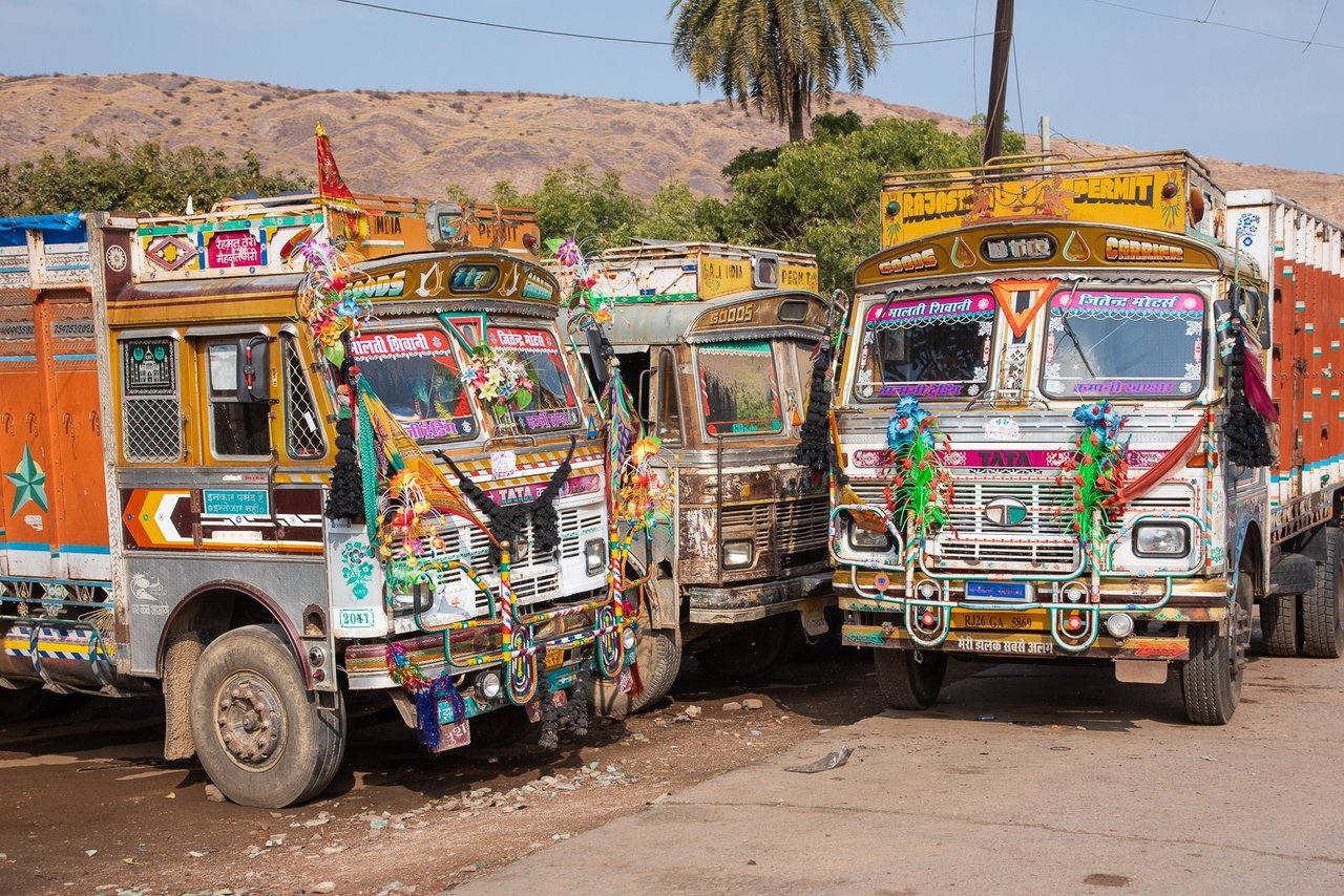 """Decorated trucks on the road to Ranthambore are""""Modern Day Elephants"""" used for commerce as well as a place to eat and sleep for the drivers. 