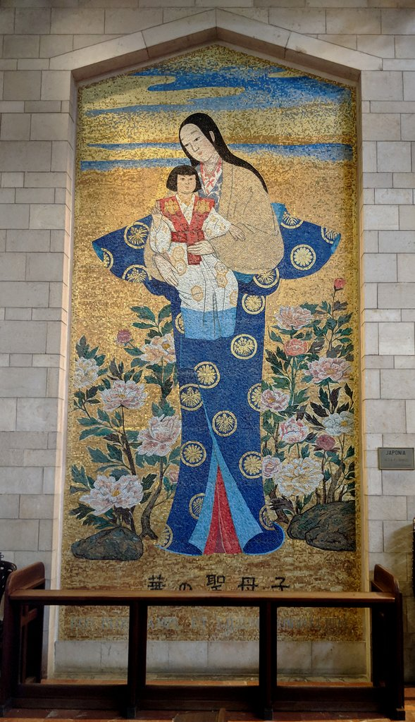 In the upper chapel of the Basilica of the Annunciation, there are a couple of dozen of paintings, mosaics, and sculptures donated by various countries of the world that depict Mary and the child Jesus.  This piece was donated by Japan, and it's wonderful to see their Asian interpretation.  - Basilica of the Annunciation, Nazareth, Israel | Photo taken by Rich W