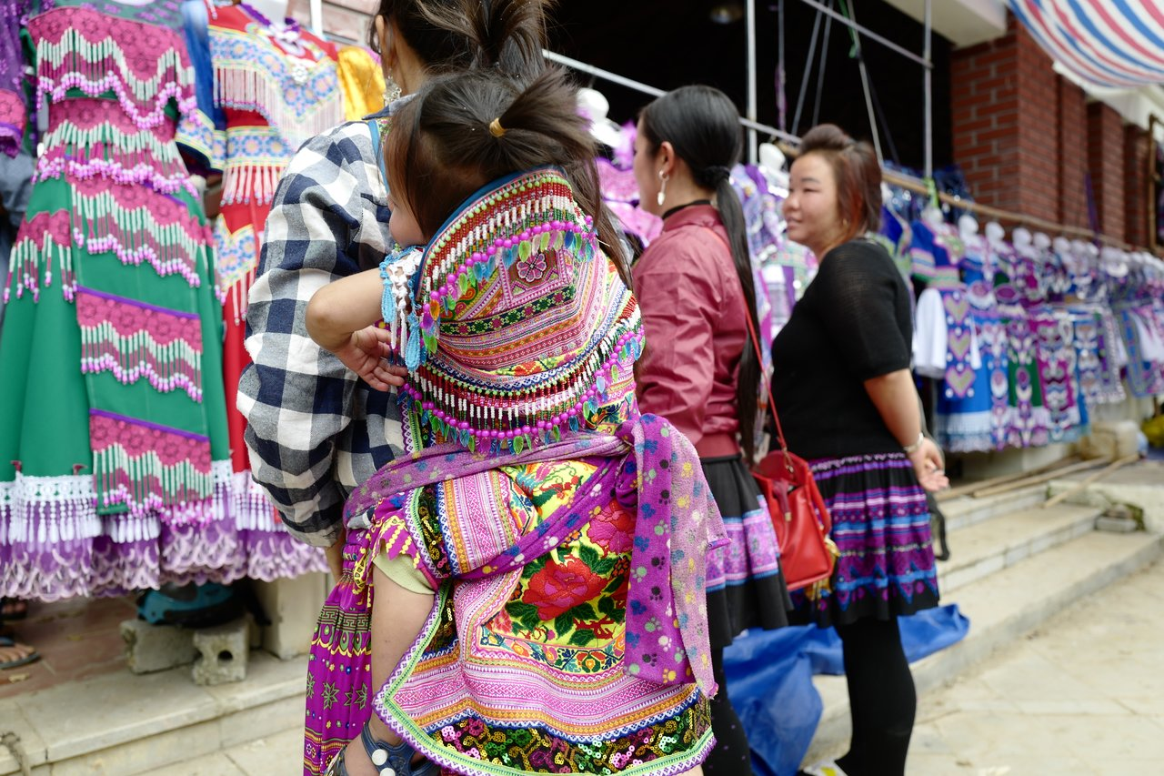 Locals decked out in their colourful ethnic wear! Babies included!   Photo taken by Su-Lin T