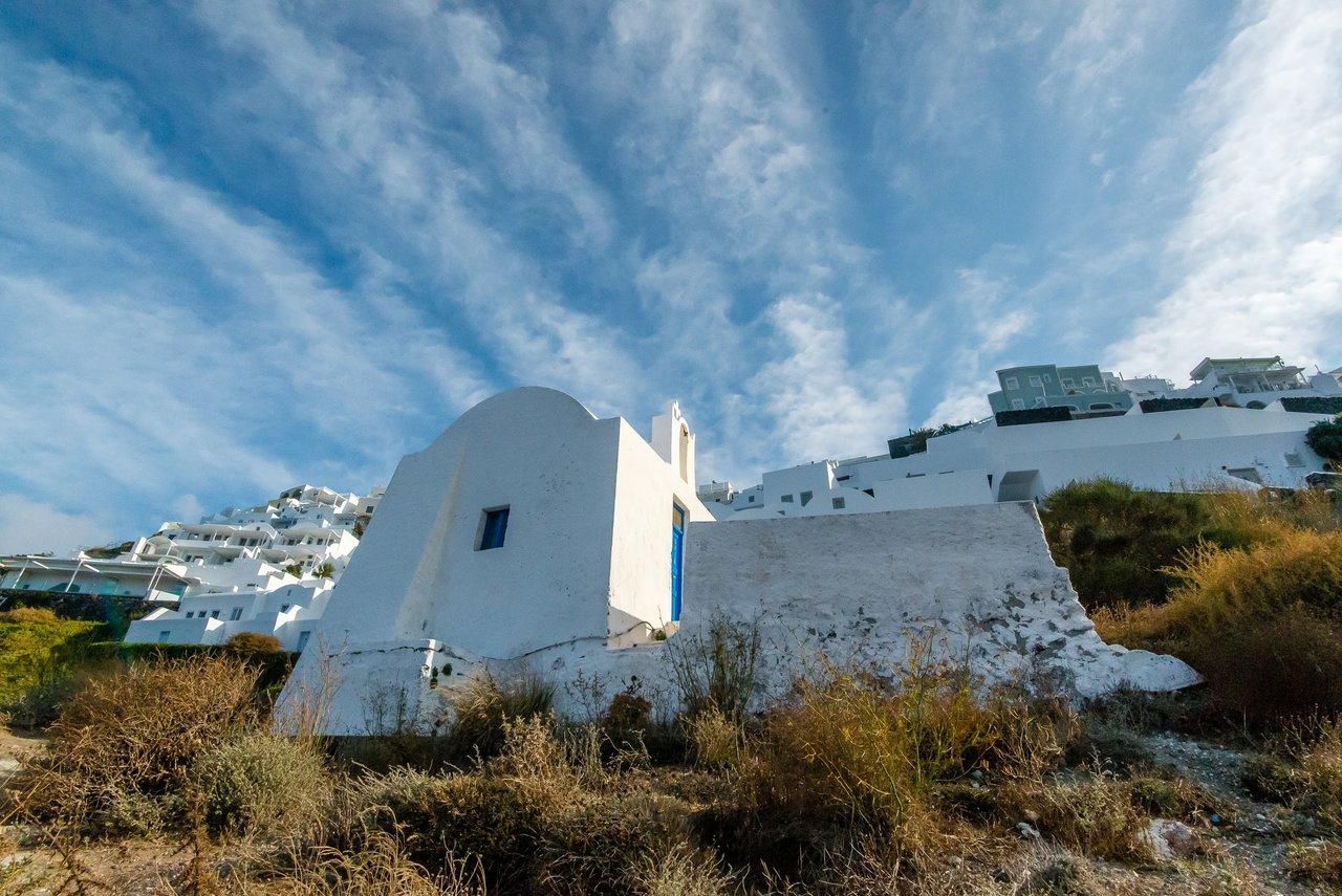 Skaros Rock monastery touching the clouds at Imerovigli | Photo taken by David B