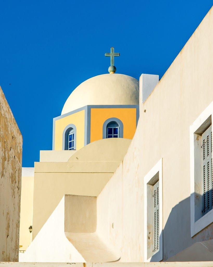 Imerovigli church dome against clear blue sky of Imerovigli | Photo taken by David B