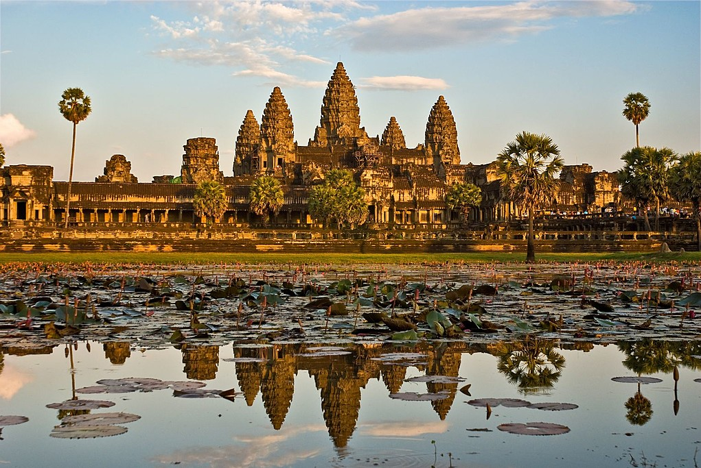 Visit the iconic Angkor Wat at sunset