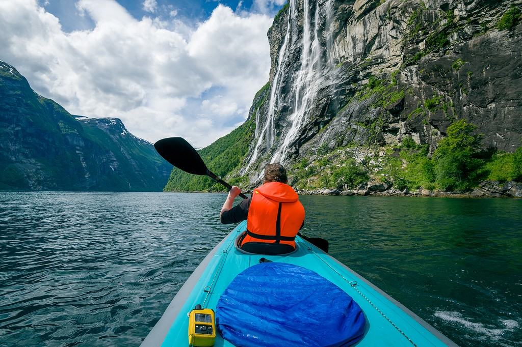 Kayaking offers spectacular views of the surrounding mountains.