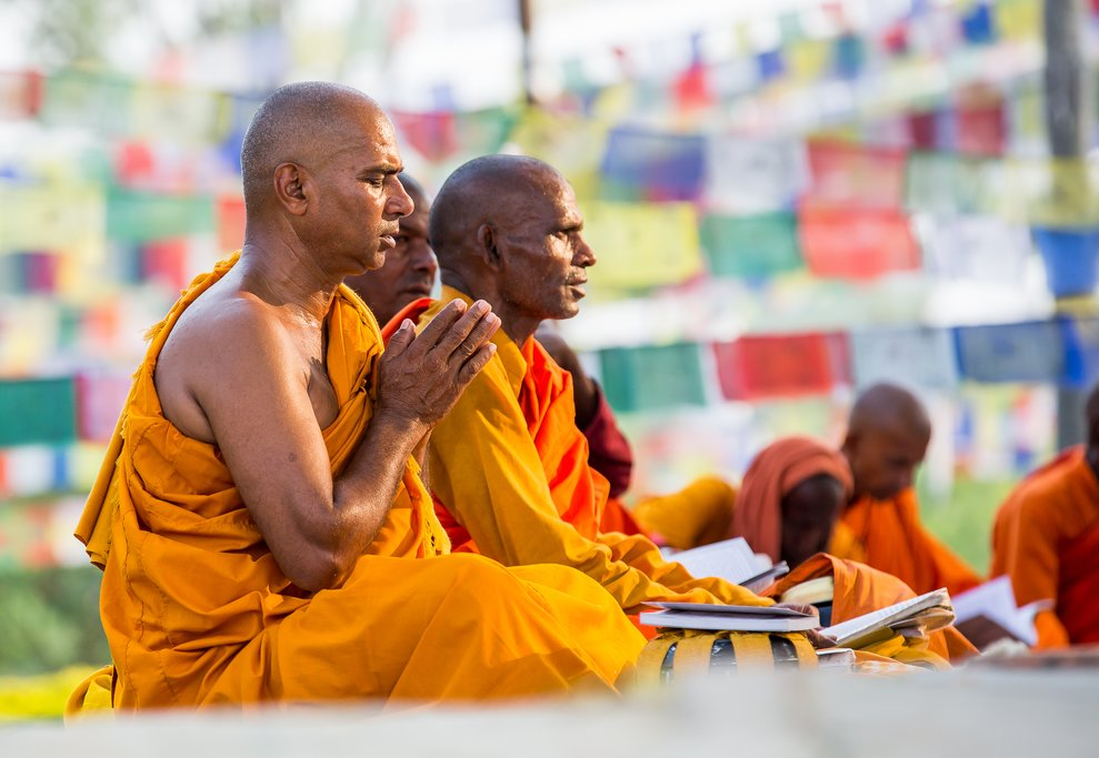 Monks from southeast Asia in prayer at Buddha's birthplace