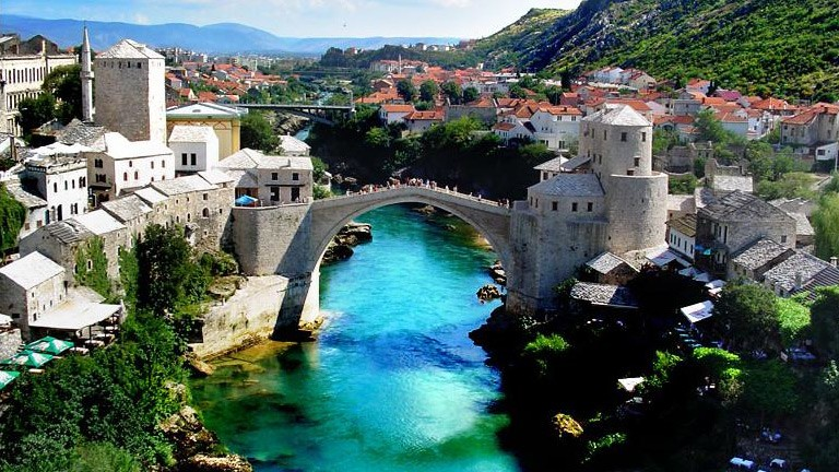 View Stari Most and surrounding Mostar