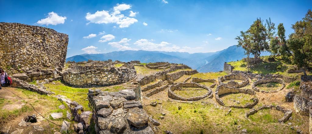Panoramic view of circular structures at Kuélap