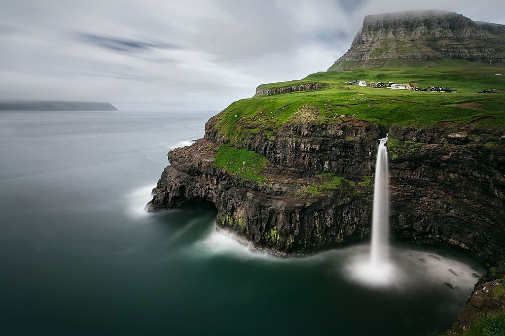 The Mulafossur waterfalls cascading into the North Atlantic