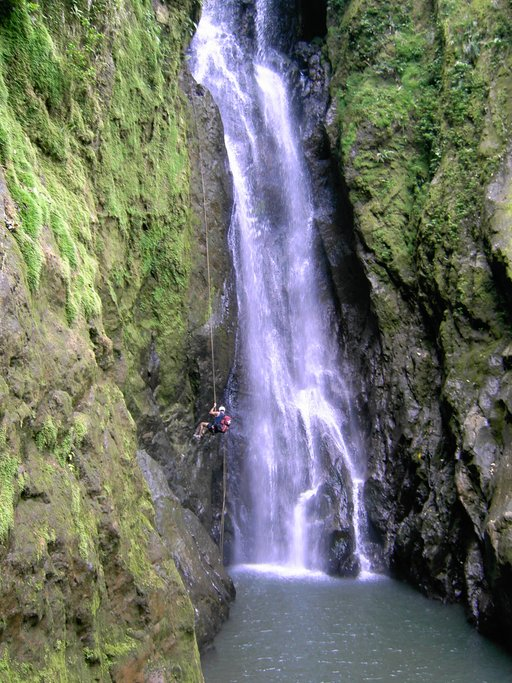 Rappeling down a waterfall in La Fortuna