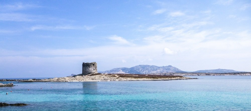 An ancient stone tower on the Sardinian shore