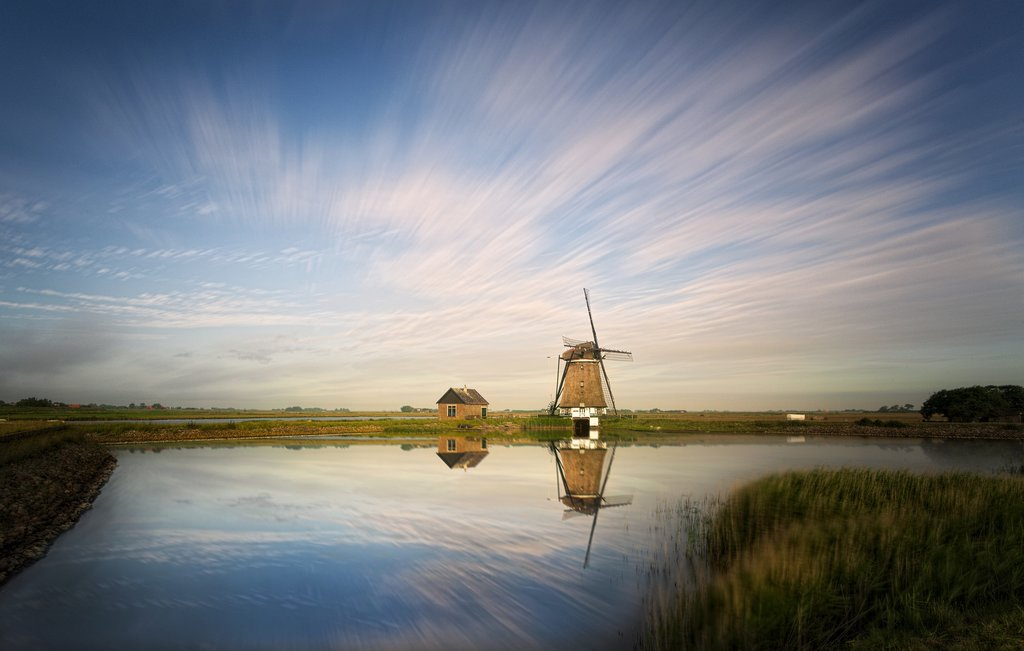 A Dutch windmill reflected in the water