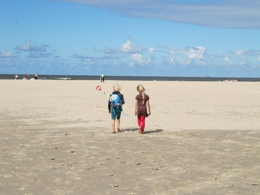 Children walking on the coast of the North Sea
