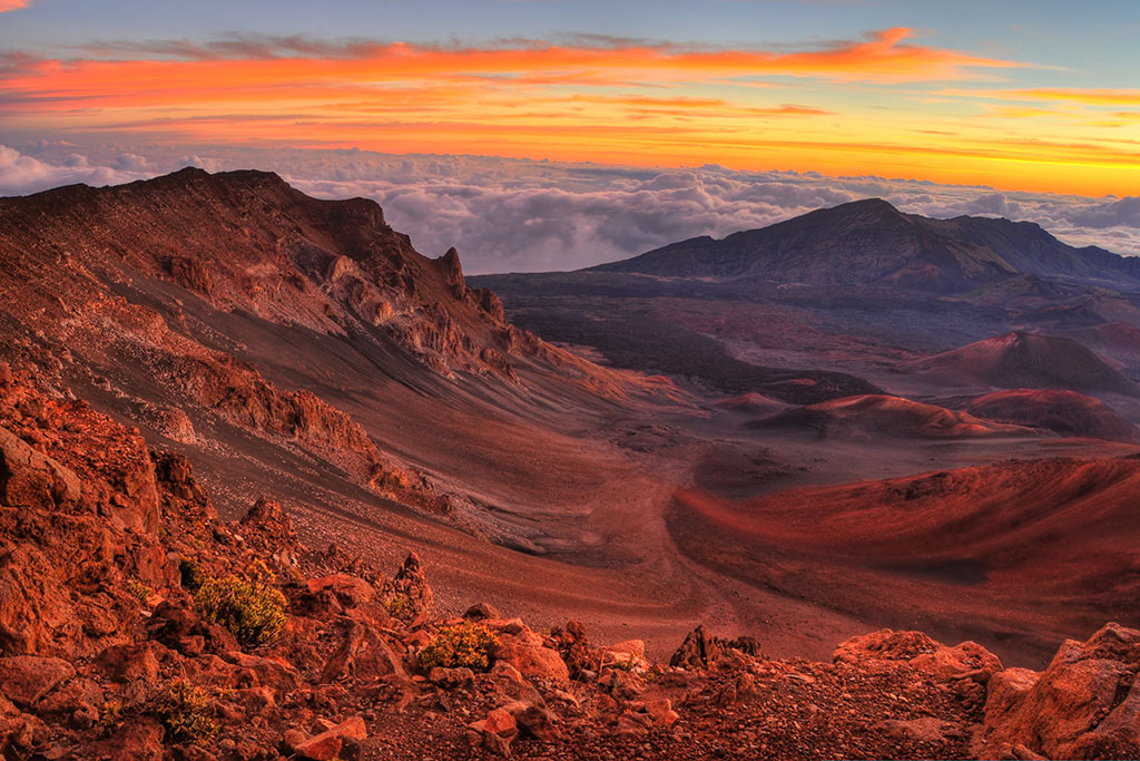 Volcanic crater landscape with beautiful orange clouds