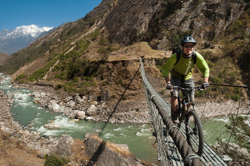 Biking across a steel bridge