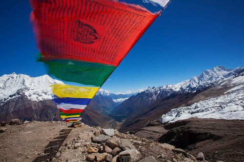 Buddhist prayer flags above the valley along the Manaslu Circuit trek